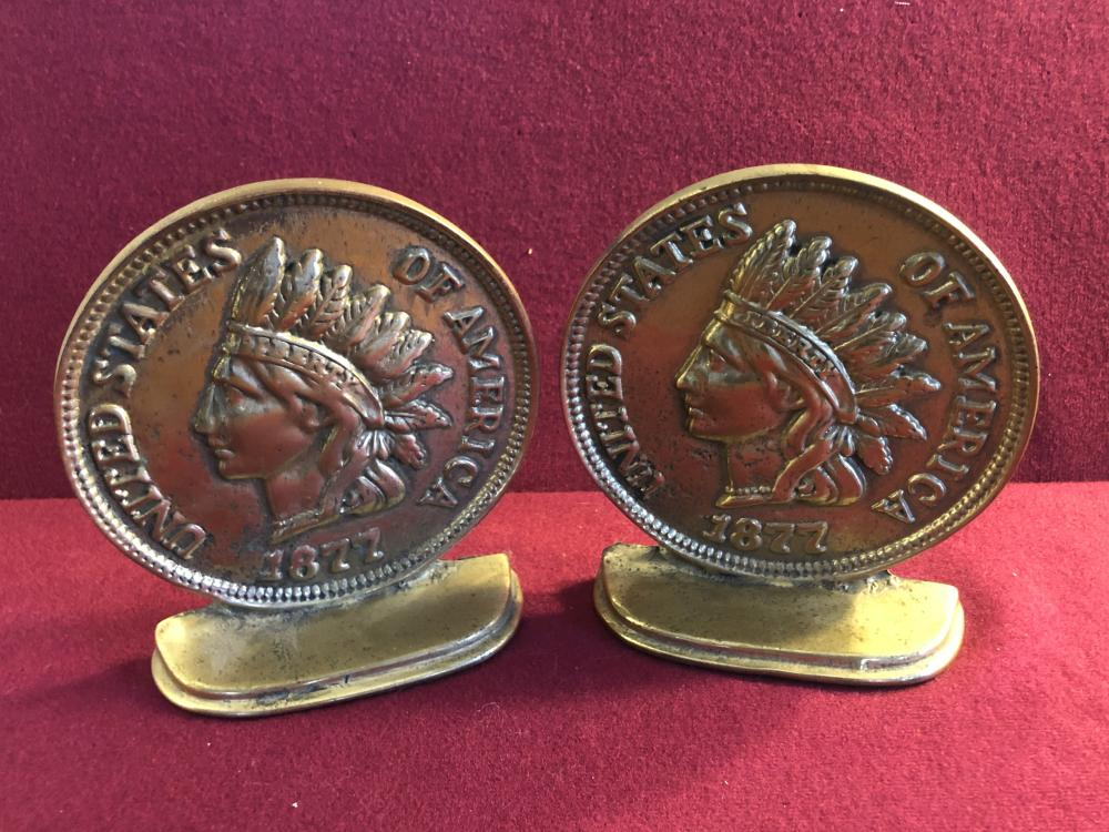 Pair of brass Indian head coin book ends