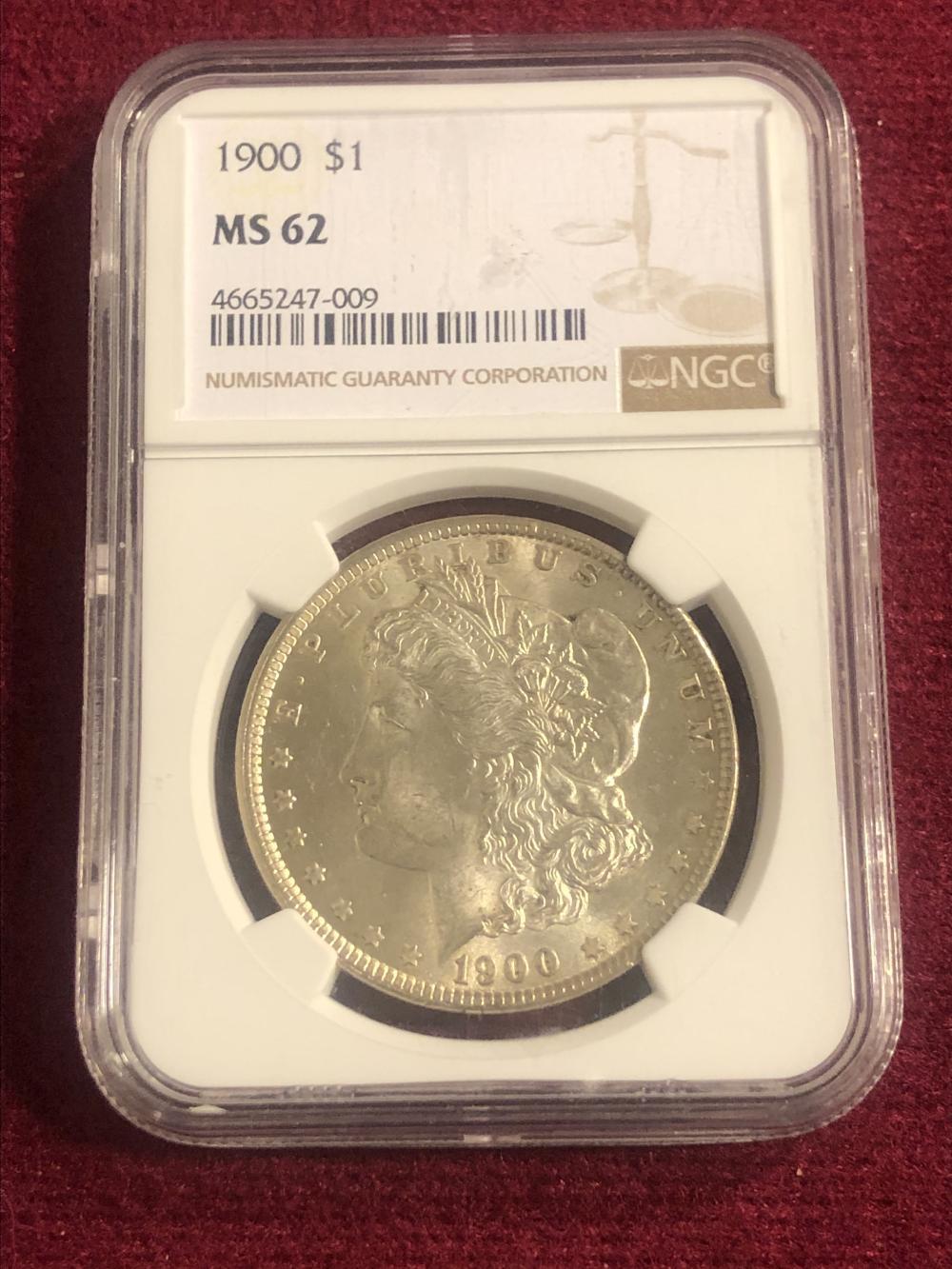 Graded 1900 Morgan silver dollar