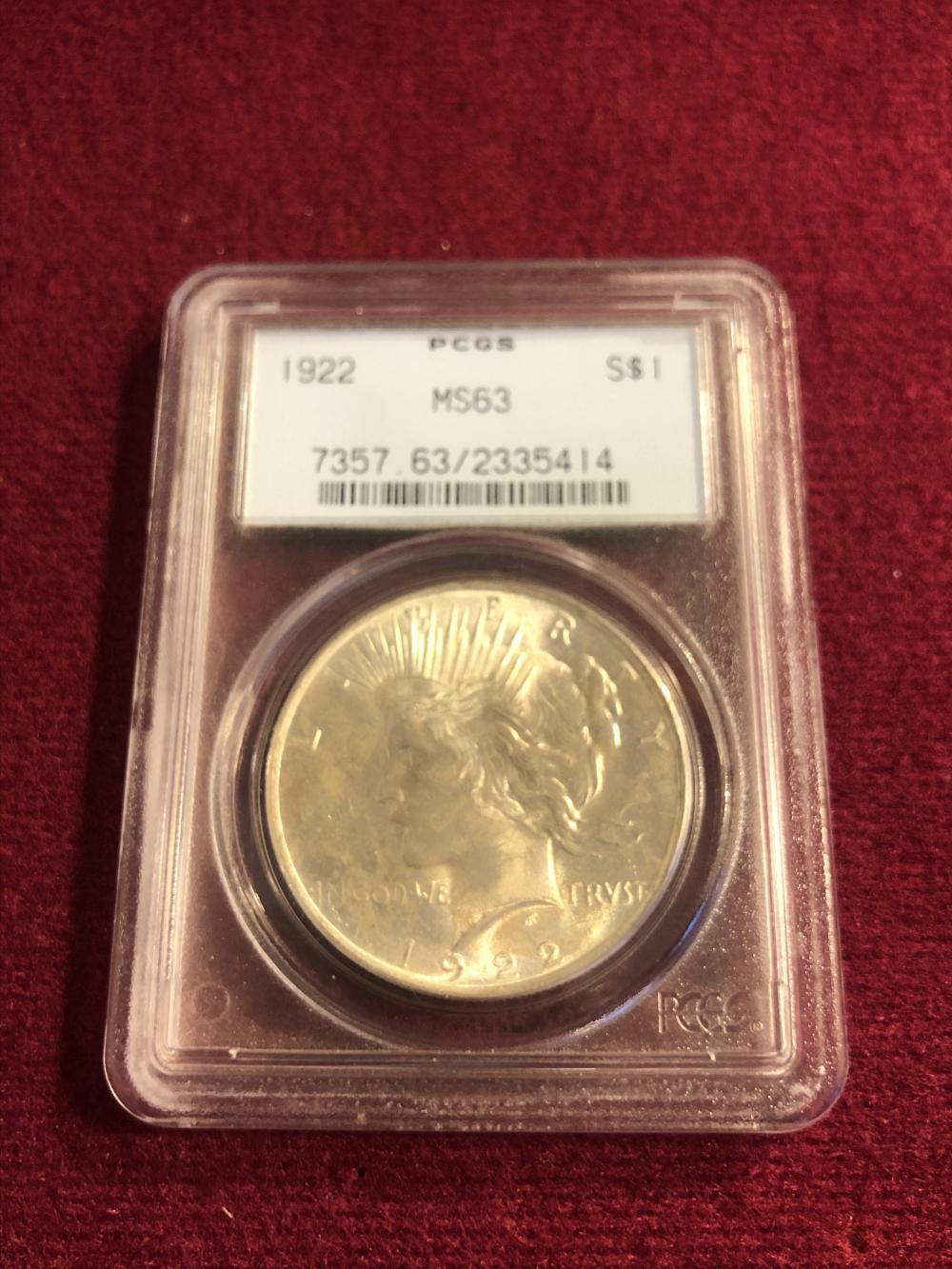 Graded 1922 peace silver dollar