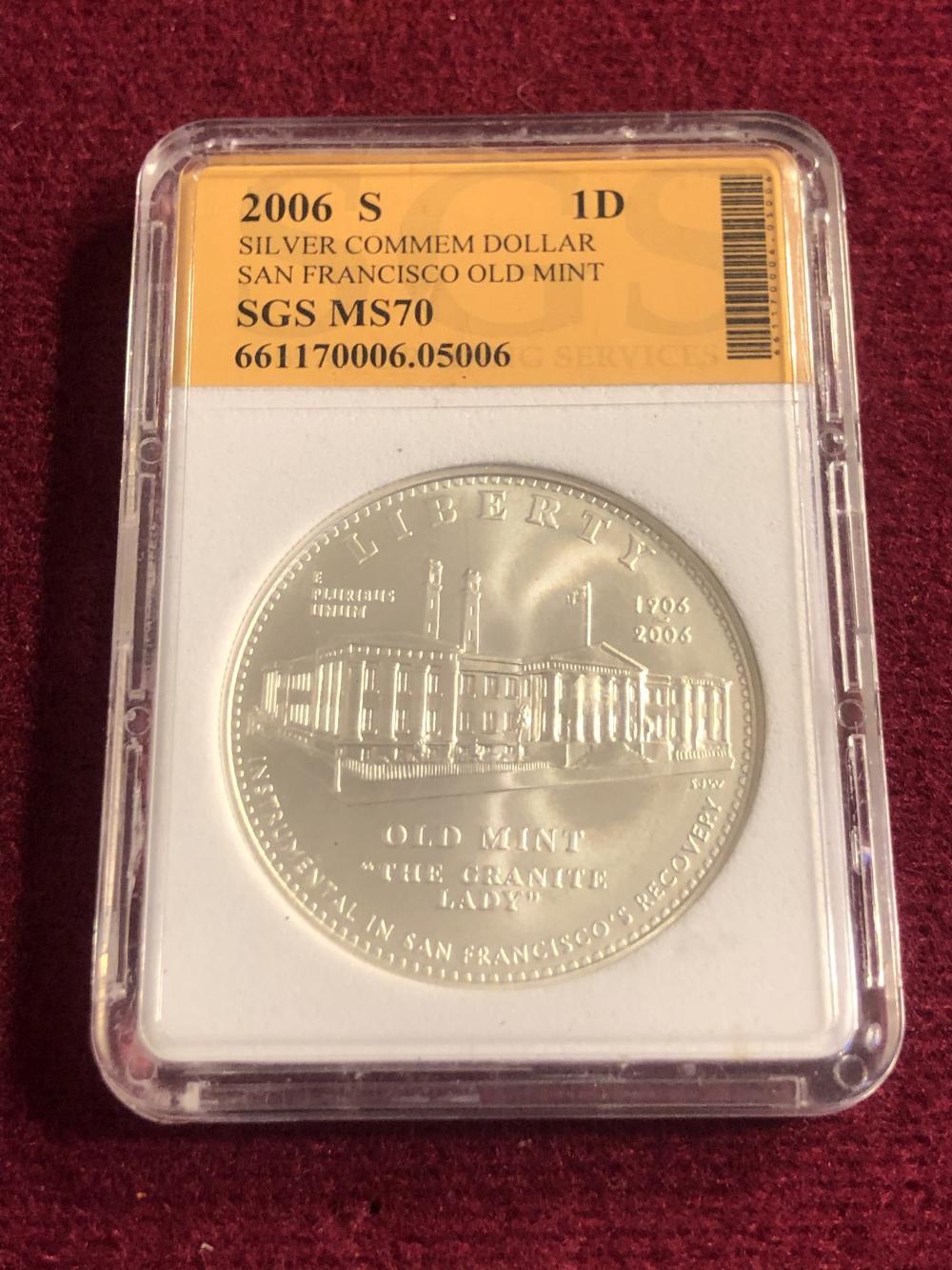 Graded 2006-S silver commemorative dollar coin