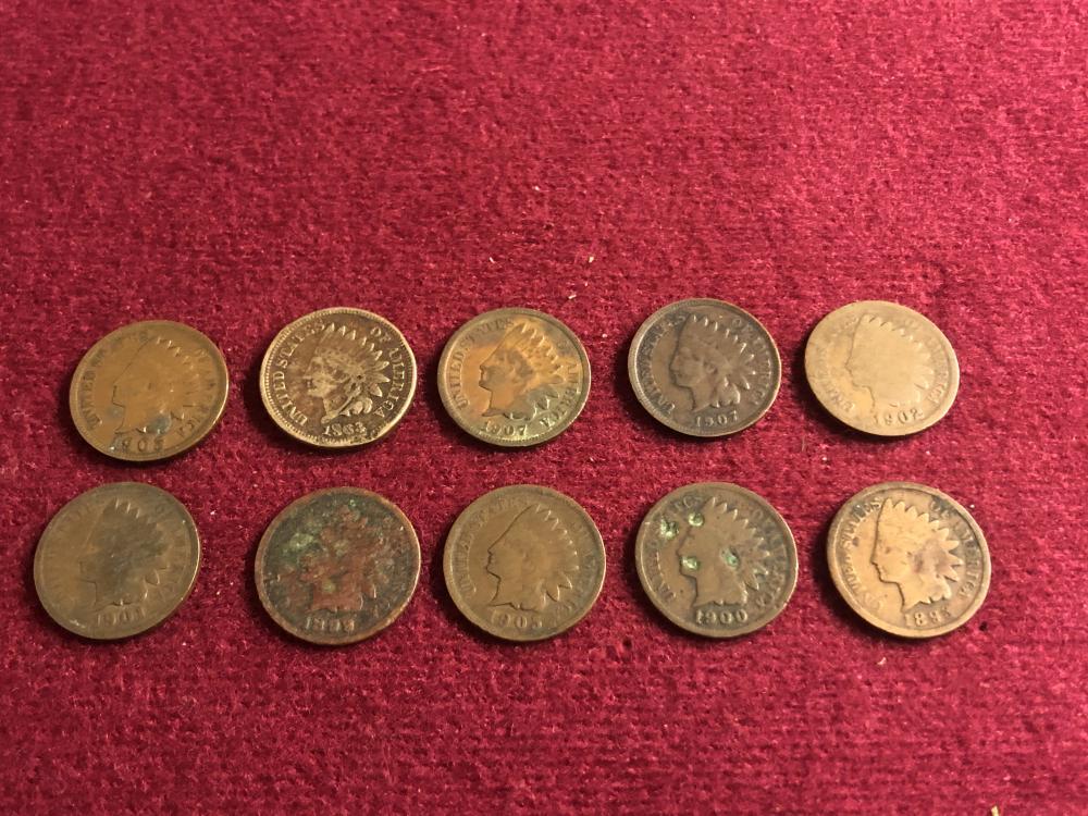 Ten Indian head pennies including 1863