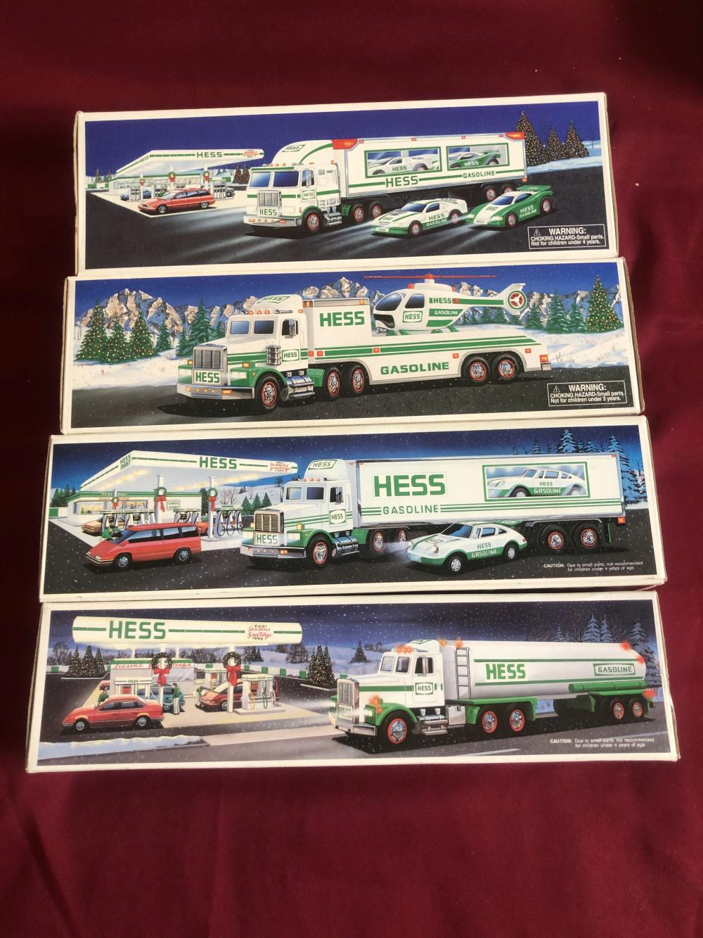 Four collectible Hess trucks in boxes