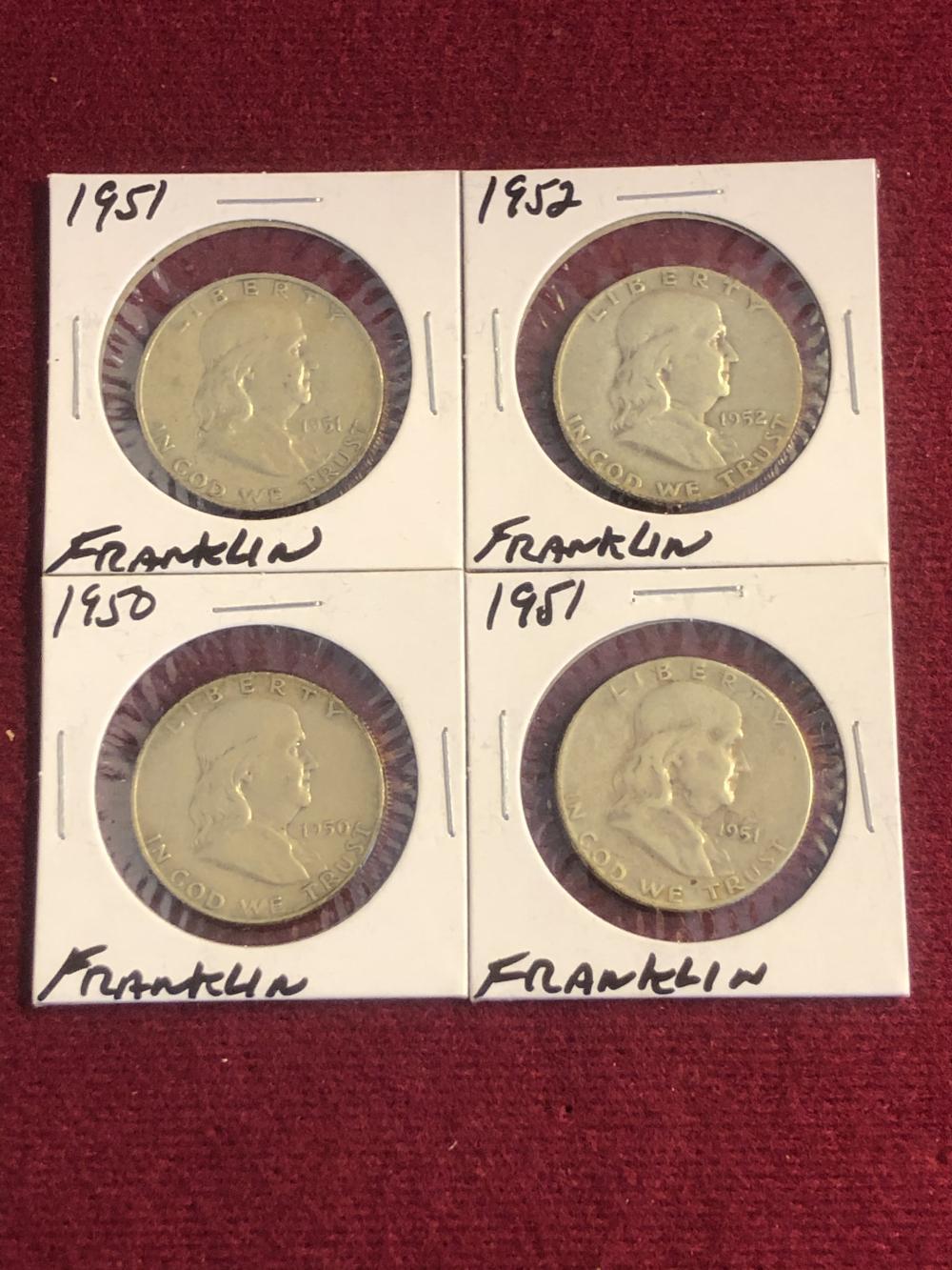 Four silver Franklin half dollars