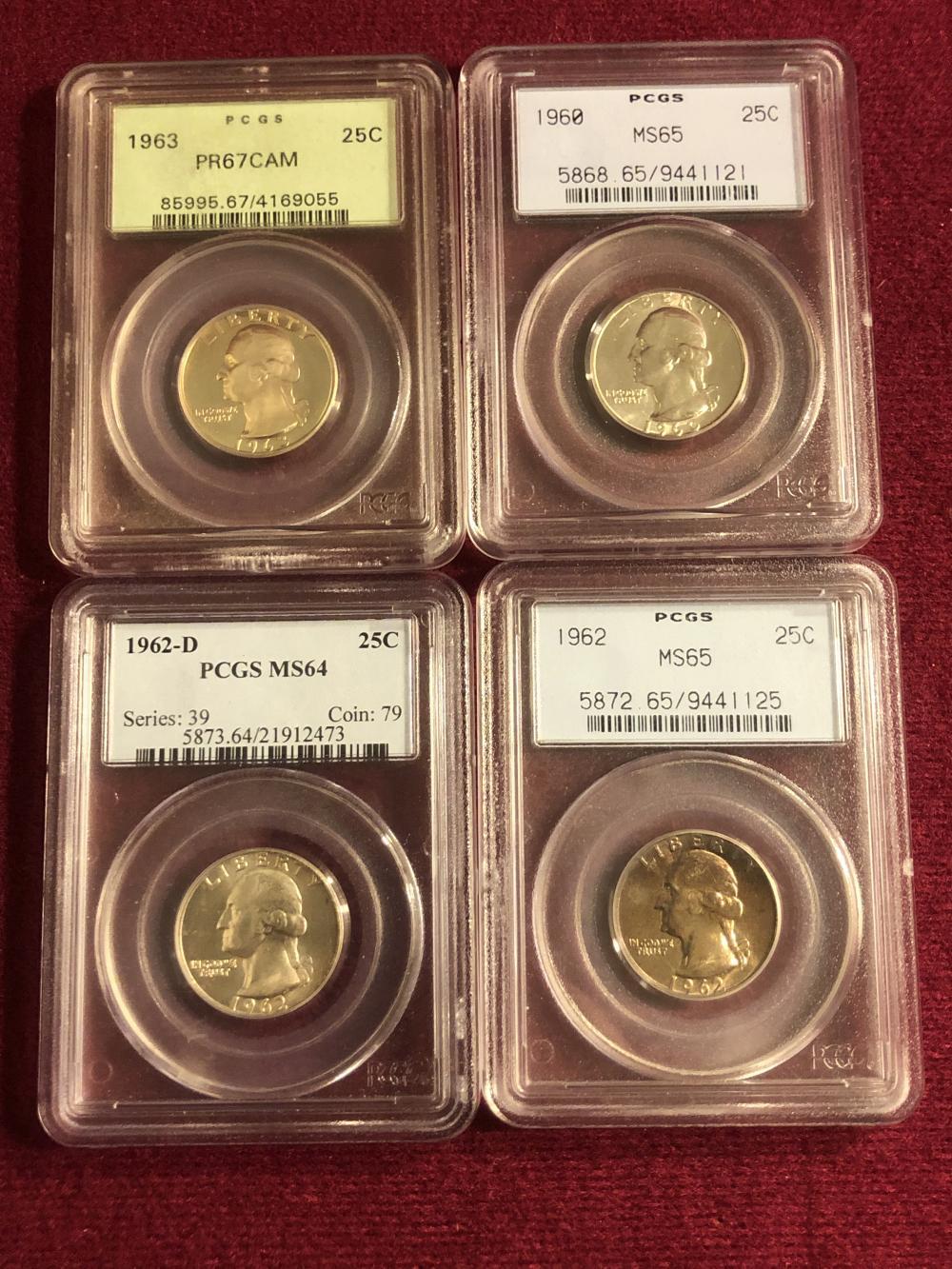 Four graded silver quarters