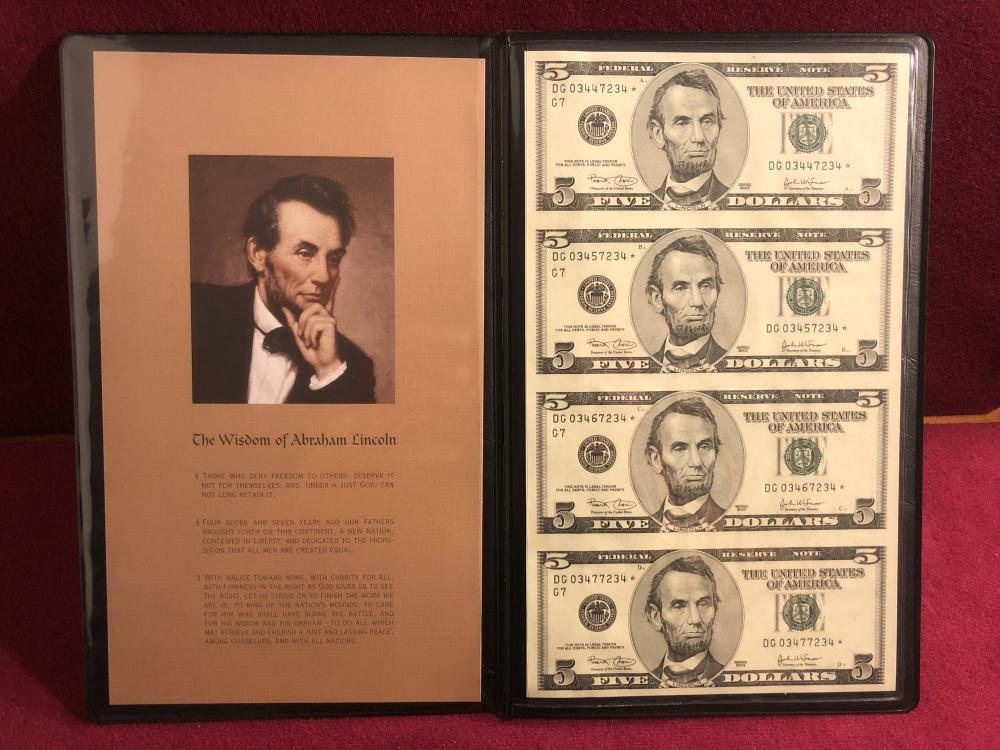 World reserve exchange four uncut two dollar bills