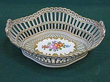 DRESDEN HANDPAINTED AND GILDED FLORAL DECORATED PIERCEWORK TWO HANDLED CERAMIC BASKET