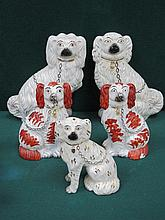 FIVE VARIOUS STAFFORDSHIRE STYLE CERAMIC SPANIELS