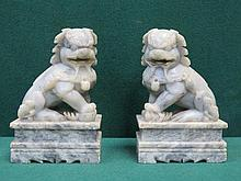 PAIR OF HEAVILY CARVED STONEWARE DOGS OF FOO, APPROXIMATELY 18cm HIGH