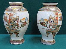 PAIR OF HANDPAINTED AND GILDED CERAMIC VASES DECORATE WITH ORIENTAL WARRIORS, APPROXIMATELY 19cm HIGH