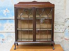 MAHOGANY BOW FRONTED TWO DOOR GLAZED DISPLAY CABINET ON BALL AND CLAW SUPPORTS