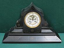 DECORATIVE BLACK SLAT MANTEL CLOCK WITH ENAMELLED DIAL, APPROXIMATELY 28cm HIGH