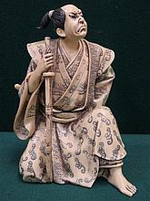 DECORATIVE ORIENTAL FIGURE OF A SAMURAI, APPROXIMATELY 23cm HIGH