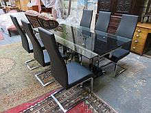 MODERN CHROME AND GLASS EXTENDING DINING TABLE WITH THREE LEAVES AND SIX HIGH BACK CHAIRS