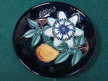 MOORCROFT TUBE LINED FLORAL DECORATED CIRCULAR CERAMIC COASTER, DIAMETER APPROXIMATELY 12cm