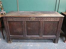 ANTIQUE OAK PANELLED AND CARVED COFFER