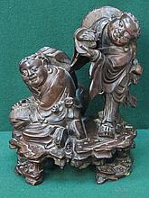 HEAVILY CARVED ORIENTAL FIGURE GROUP DEPICTING THE