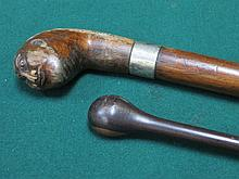 INTERESTING CARVED WALKING STICK WITH SILVER COLOU