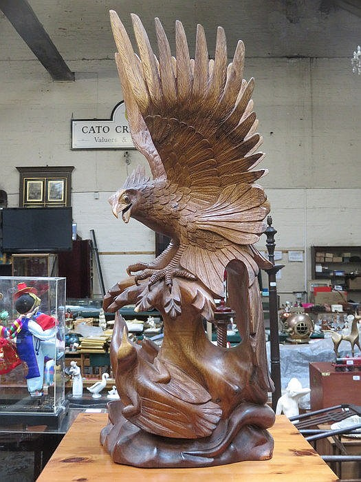 LARGE TREEN CARVING DEPICTING AN EAGLE AND EAGLETS, APPROXIMATELY 70cm HIGH