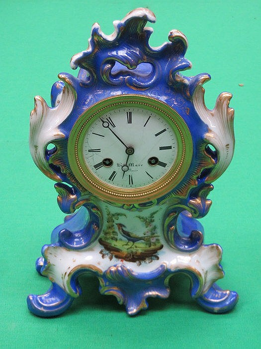 FRENCH STYLE HANDPAINTED AND GILDED PORCELAIN MANTEL CLOCK (AT FAULT)