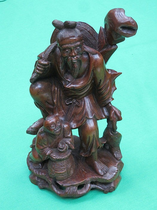 HEAVILY CARVED ORIENTAL STYLE FIGURE GROUP, APPROXIMATELY 28cm HIGH