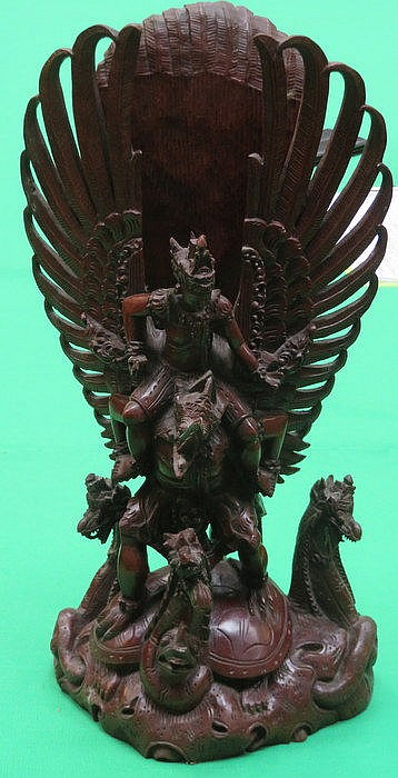 INDONESIAN CARVING DEPICTING A MYTHICAL CREATURE, APPROXIMATELY 39cm HIGH