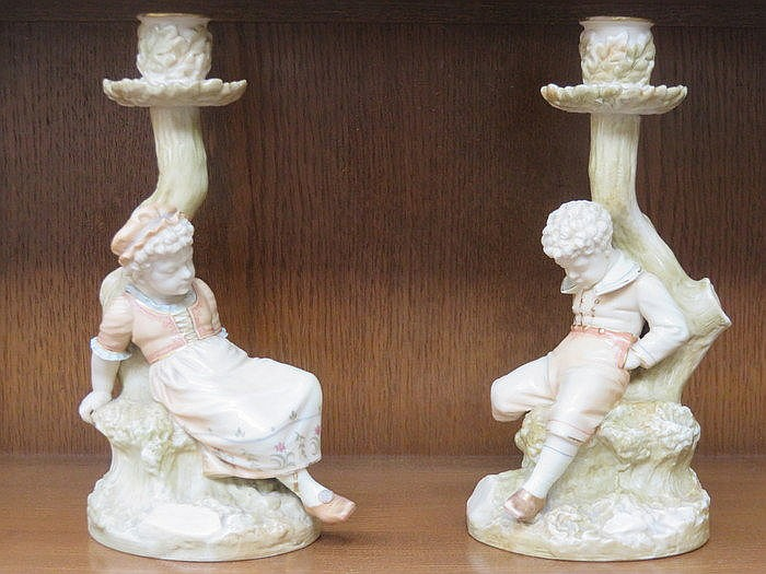 PAIR OF ROYAL WORCESTER HANDPAINTED AND GILDED FIGURE FORM CANDLESTICKS, No