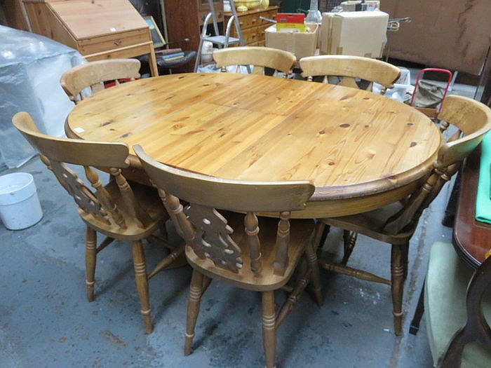 PINE CIRCULAR EXTENDING DINING TABLE AND SIX CHAIRS