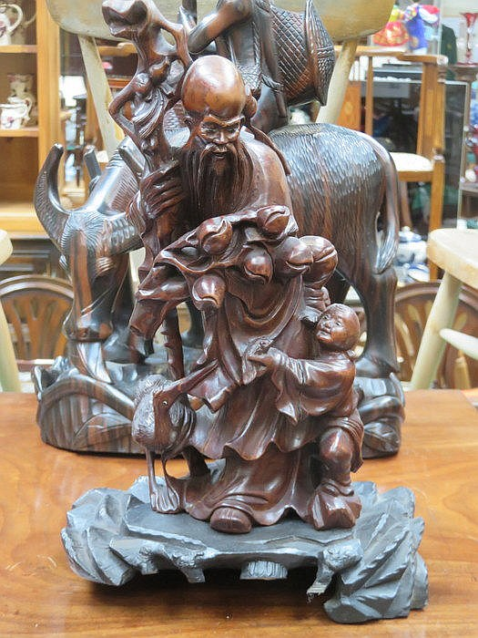 HEAVILY CARVED ORIENTAL FIGURE GROUP ON STAND, APPROXIMATELY 35cm HIGH