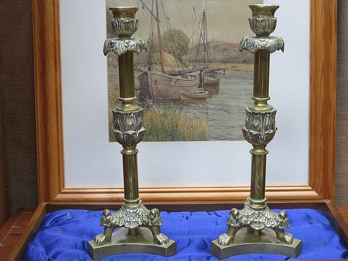 PAIR OF BRASS CANDLESTICKS ON RAISED SUPPORTS, APPROXIMATELY 31cm HIGH