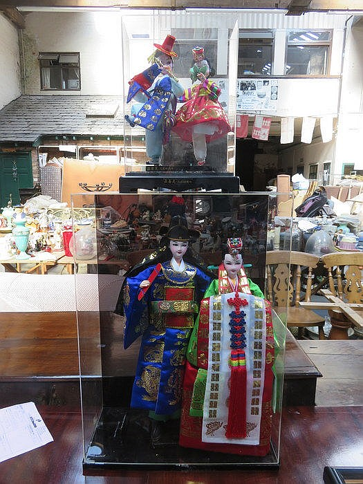 TWO PERSPEX DISPLAY CASES CONTAINING ORIENTAL DOLLS
