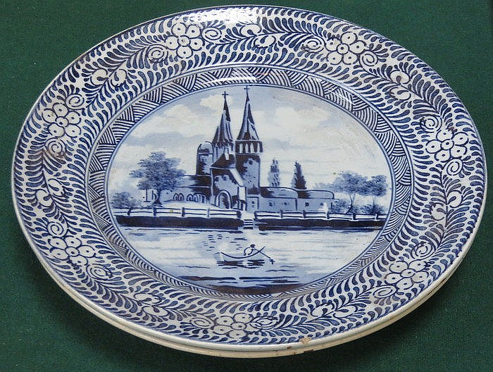 TWO DELFT STYLE CONTINENTAL BLUE AND WHITE CERAMIC PLATES (AT FAULT)
