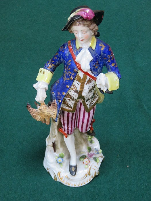 CONTINENTAL HANDPAINTED AND GILDED CERAMIC FIGURE OF A GENT, STAMPED WITH G