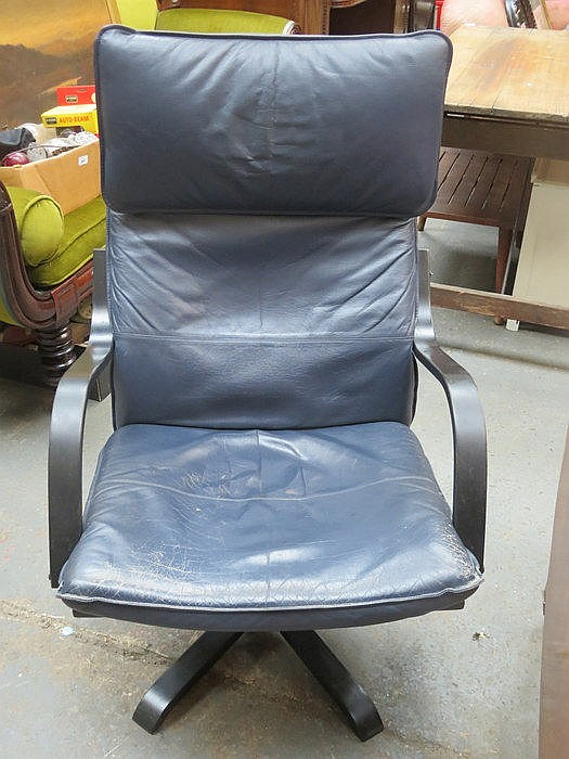 LEATHER UPHOLSTERED SWIVEL ARMCHAIR
