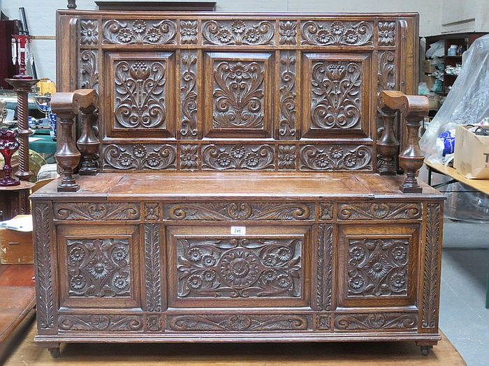 HEAVILY CARVED OAK MONK'S BENCH