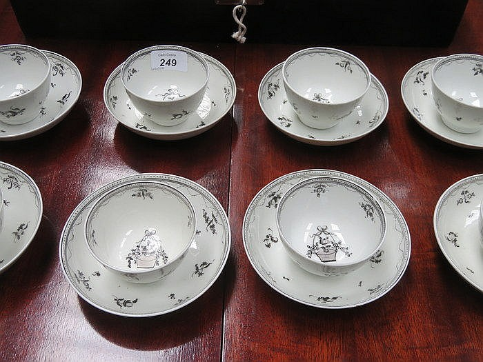 SET OF EIGHT EARLY HANDPAINTED CERAMIC TEA BOWLS AND SAUCERS