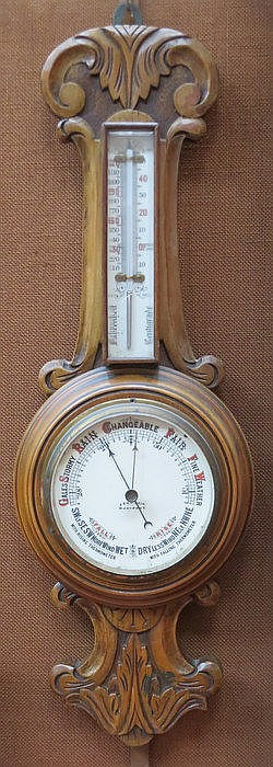 SMALL CARVED WOODEN CASED ANEROID BAROMETER BY JOHN BAIN, MARY PORT
