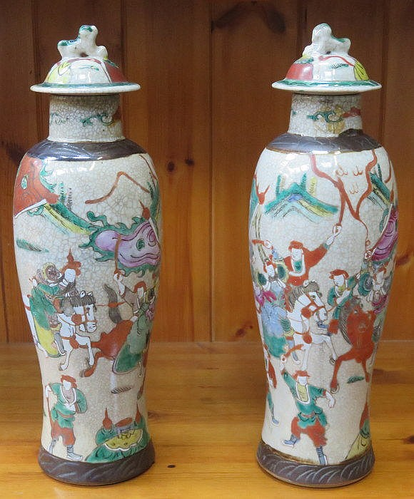 PAIR OF DECORATIVE POTTERY VASES WITH COVERS DECORATED WITH ORIENTAL SCENES