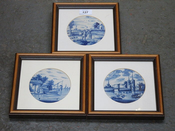 SET OF THREE FRAMED BLUE AND WHITE CERAMIC TILES