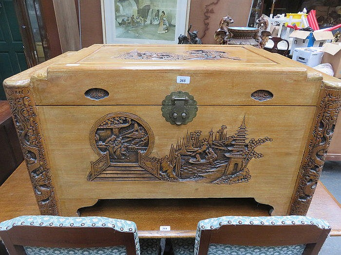 HEAVILY CARVED ORIENTAL CAMPHOR CHEST