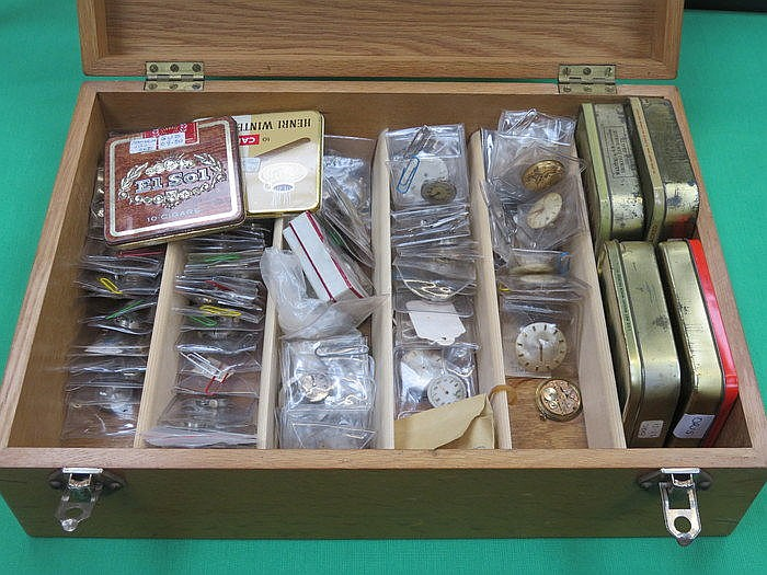 OAK CASE CONTAINING VARIOUS WATCH PARTS AND ACCESSORIES