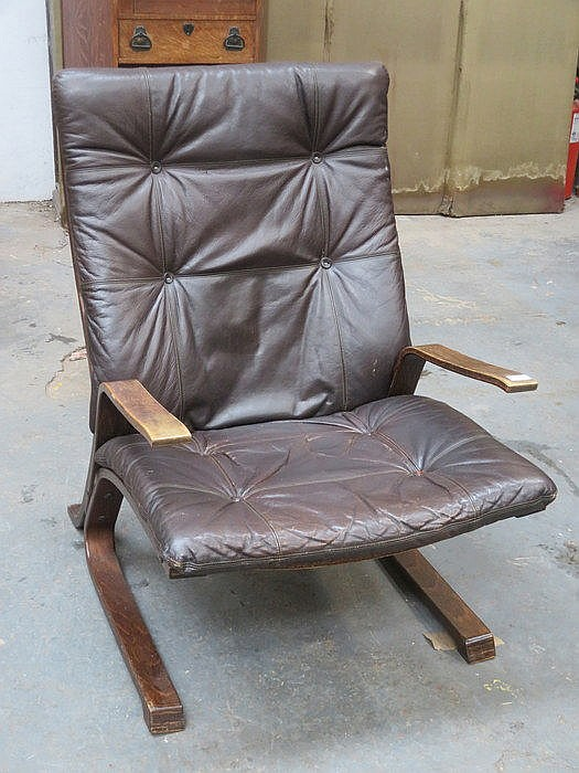 LOW SEATED LEATHER UPHOLSTERED BENTWOOD ARMCHAIR