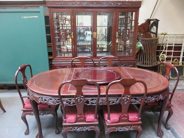 CARVED ANTIQUE ORIENTAL HARDWOOD DINING SUITE COMPRISING OF EXTENDING DININ