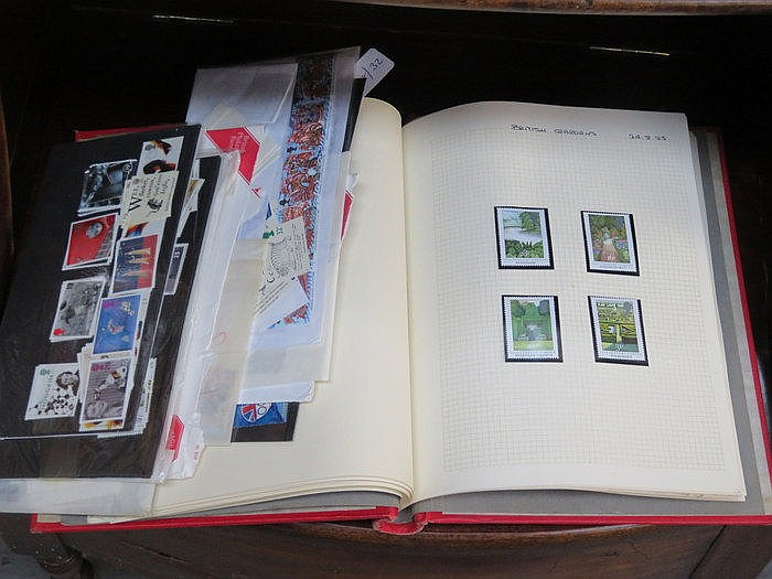 TWO ALBUMS CONTAINING VARIOUS BRITISH AND OTHER POSTAGE STAMPS PLUS DAILY P