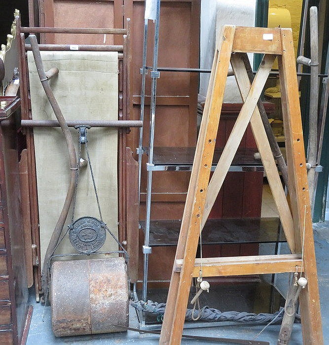 CAST IRON FRAMED ROLLER AND DECK CHAIR, SYTHES AND ARTIST'S EASEL