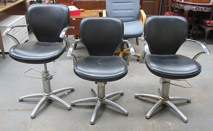 THREE BLACK LEATHER EFFECT AND CHROME BARBERS CHAIRS