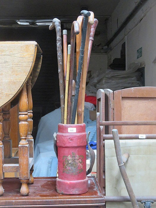 STAND BEARING COAT OF ARMS AND SWAGGER STICK PLUS WALKING STICKS, ETC.