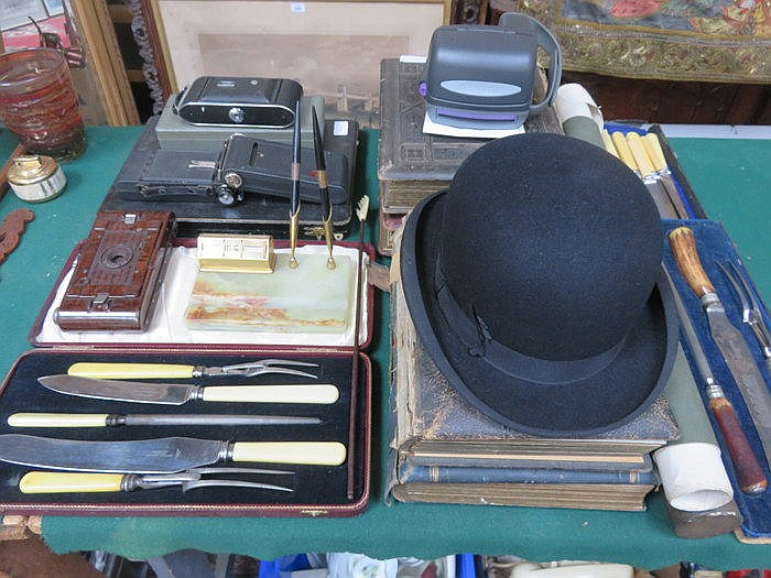 BOXED AND UNBOXED FLATWARE, CAMERAS, DESK STAND, VOLUMES AND BOWLER HAT, ET