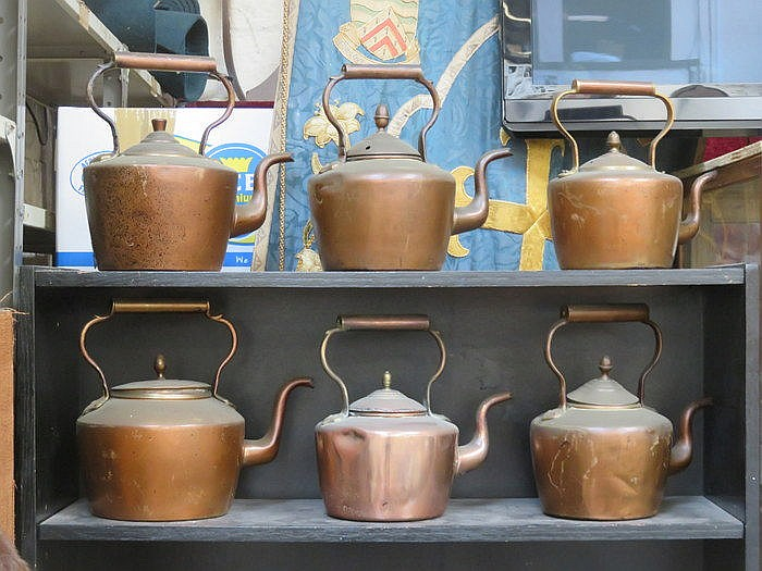 SIX COPPER KETTLES