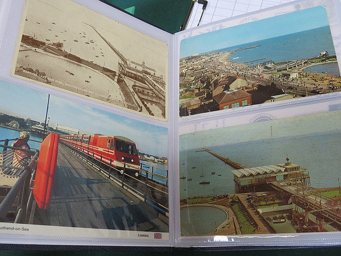 THREE ALBUMS OF VARIOUS POSTCARDS INCLUDING PIERS, ADVERT POSTERS, BAND STA