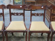 SET OF FOUR HEAVILY CARVED ANTIQUES MAHOGANY DINING CHAIRS